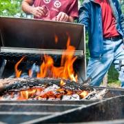 Men Baking Cake Over Fire